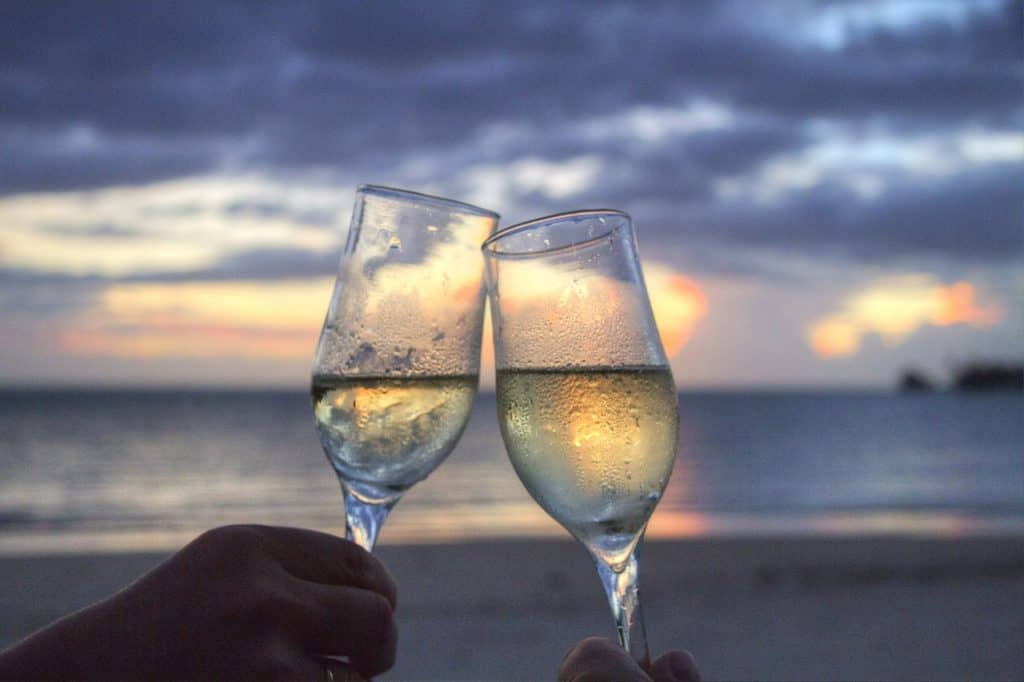 Two glasses of wine in front of a sunset - stingray villa, Cozumel